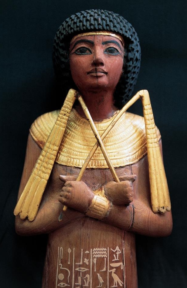 Slide 12 of 18: Ushabti, funerary statuette in gilded wood, from the Tomb of Tutankhamun. Egyptian civilisation, Dynasty XVIII. De Agostini / W. Buss/Getty Images