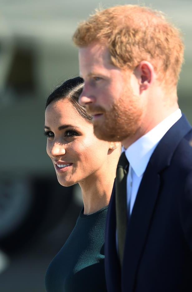 Slide 77 of 86: Britain's Prince Harry and his wife Meghan, the Duke and Duchess of Sussex, arrive at the airport for a two-day visit to Dublin, Ireland July 10, 2018.  REUTERS/Cathal McNaughton