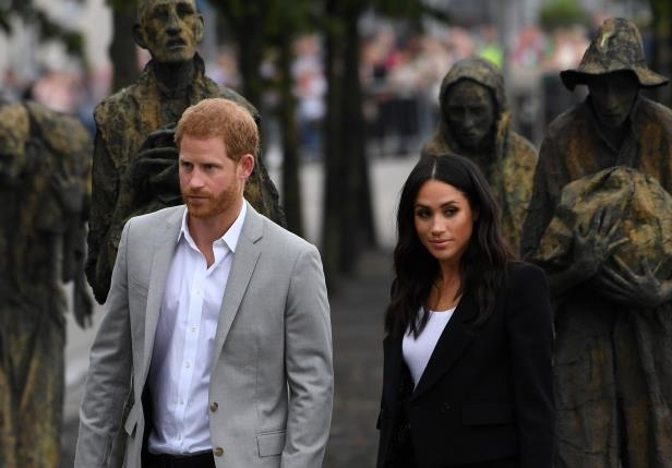 Slide 84 of 86: Prince Harry and Meghan, the Duchess of Sussex, visit the Famine Memorial in Dublin. REUTERS/Cathal McNaughton