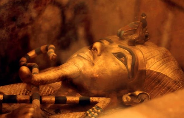 Slide 9 of 18: One of Egypt's famed King Tutankhamun's golden sarcophagus is displayed at his tomb in a glass case at the Valley of the Kings in Luxor, Egypt, Friday, April 1, 2016. Egypt's archaeologists have completed more extensive scanning of two recently discovered chambers behind King Tut's tomb in the Valley of the Kings. (AP Photo/Amr Nabil)
