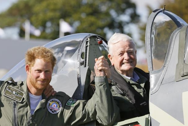 Wing Commander Tom Neil, who has died aged 97, meeting Prince Harry during Battle of Britain commemorations: Wing Commander Tom Neil, who has died aged 97, met Prince Harry during Battle of Britain commemorations (Kirsty Wigglesworth/PA)