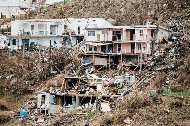 a boat sitting on top of a dirt field: The United States Virgin Islands were hit by Hurricane Irma in September 2017. FEMA sent aid there from its Puerto Rico warehouse, leaving little on hand when Hurricane Maria struck two weeks later, the report says.