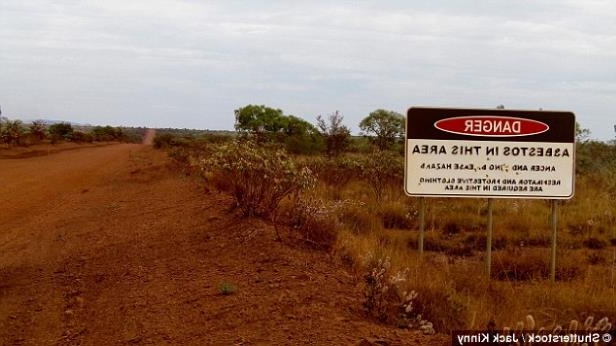 a close up of a sign: The former Western Australian mining town of Wittenoom attracts many tourists, despite department warnings about its deadly past