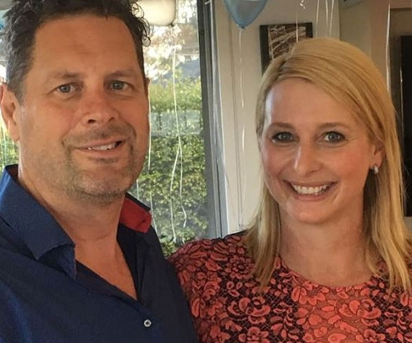 a man and a woman smiling for the camera: Johanna Griggs and Todd Huggins.