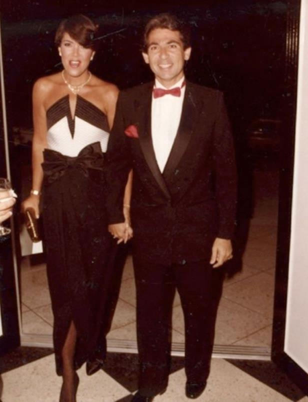 a man wearing a suit and tie posing for a photo: Kris Jenner and Robert Kardashian Sr.