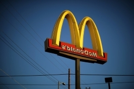a sign on the side of a building: The logo of a McDonald's Corp restaurant is seen in Los Angeles.