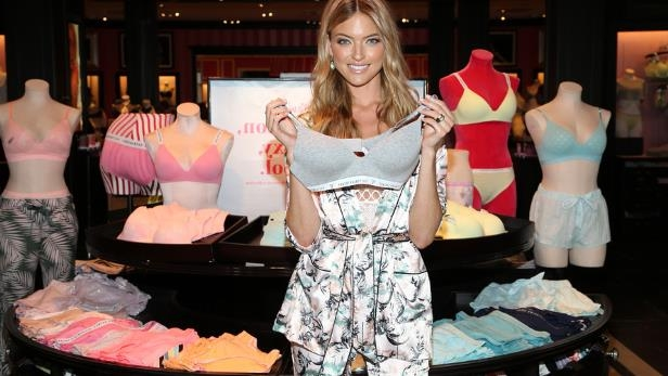 a woman holding a birthday cake: Victoria's Secret is struggling to sell lingerie even during its semiannual sale