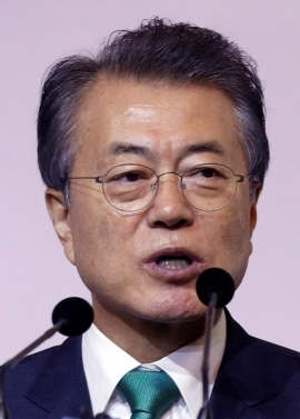 Moon Jae-in wearing glasses and smiling at the camera: South Korea's President Moon Jae-in speaks at the ISEAS 42nd Singapore Lecture in Singapore