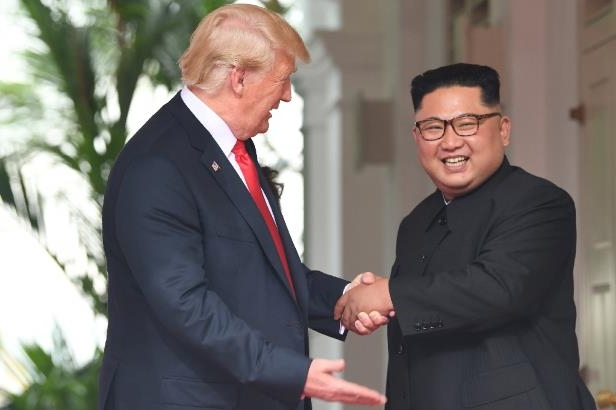 North Korean leader Kim Jong Un and President Donald Trump at the start of their historic summit last month