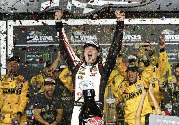 Slide 1 of 19: DAYTONA BEACH, FL - JULY 07:  Erik Jones, driver of the #20 buyatoyota.com Toyota, celebrates in Victory Lane after winning the Monster Energy NASCAR Cup Series Coke Zero Sugar 400 at Daytona International Speedway on July 7, 2018 in Daytona Beach, Florida.  (Photo by Brian Lawdermilk/Getty Images)