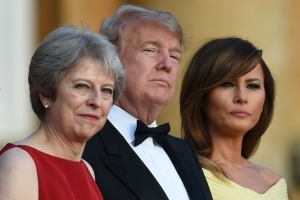 Trump attends lavish dinner with May amid protests