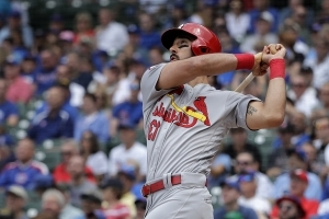 Cards' Carpenter hits 3 HRs, 2 doubles in 6 innings, exits