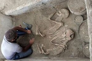 5,000-year-old 'Romeo and Juliet lovers' are found buried side-by-side near haunting skeletons of two sacrificed horses pulling a chariot into the afterlife