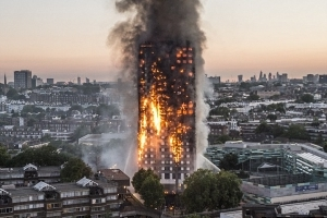 Government says it will take control of Grenfell Tower site when police probe ends after bereaved families reacted angrily to claim it may be handed back to council