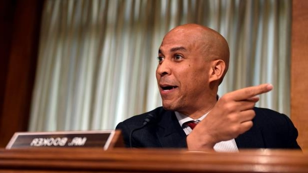 Cory Booker wearing a suit and tie: U.S. Sen. Cory Booker, D-N.J., participates in a Senate Foreign Relations Committee hearing on July 25, 2018.