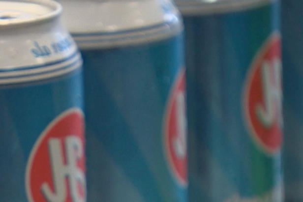 a close up of a can: Henderson Brewing Company is among a group of Toronto microbreweries who say aluminum tariffs imposed by the federal government threaten to force them out of business.