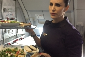 Flight attendants share the worst thing you can order on a plane—and the hardest part of the job