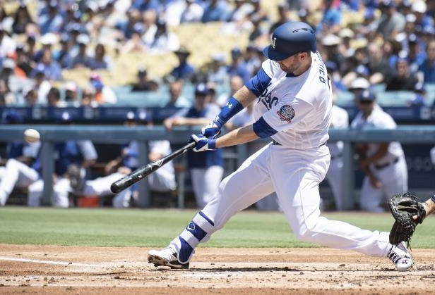 Los Angeles Dodgers' Brian Dozier hits a two-run double during the first inning of a baseball game against the Houston Astros in Los Angeles, Sunday, Aug. 5, 2018. (AP Photo/Kyusung Gong)