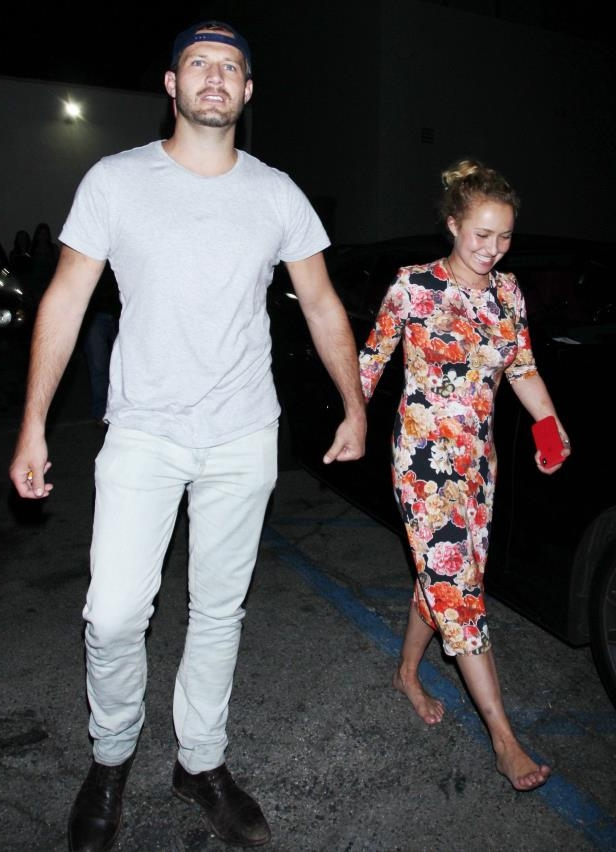 a group of people posing for the camera: A barefoot Hayden Panettiere holds hands with a mystery man in Los Angeles on Aug. 2, 2018.