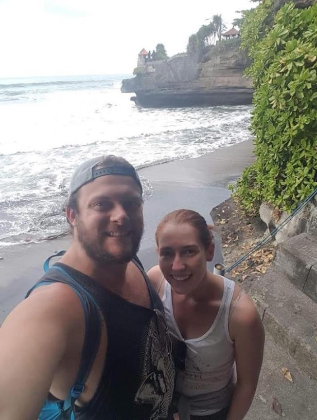 a woman standing next to a body of water posing for the camera: While on vacation, Gatineau couple Alexandria Duchaussoy-Girard and Olivier Hamel have felt the effects of two earthquakes that have hit Indonesia in the past two weeks.