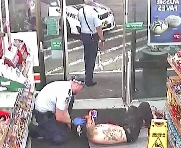 a man standing in front of a store: Amati pleaded not guilty to attacking Benjamin Rimmer (pictured being treated after the attack), Sharon Hacker and Shane Redwood in the early hours of January 7, 2017