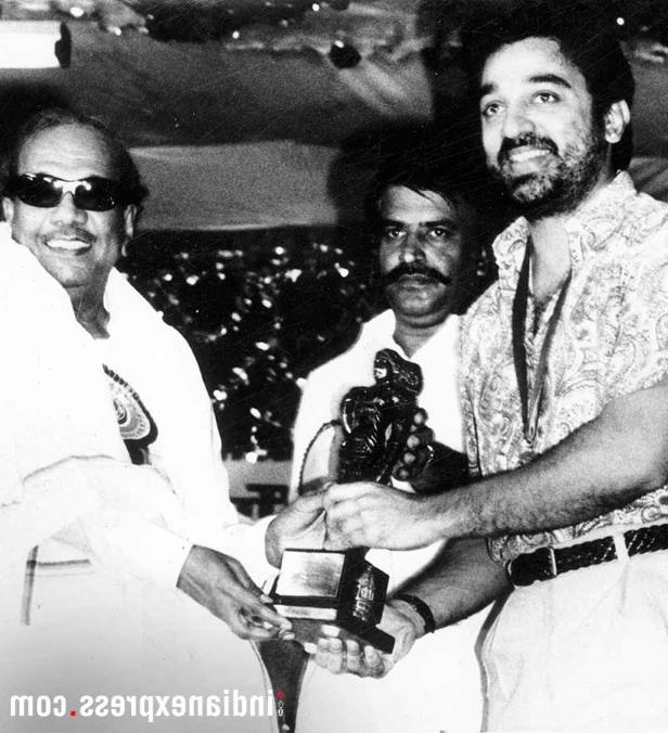 Slide 7 of 15: Apart from being a politician, he was also a playwright and screenwriter in Tamil cinema. In Pic: Film star Kamal Hassan receiving an award from M Karunanidhi. (Express archive photo)