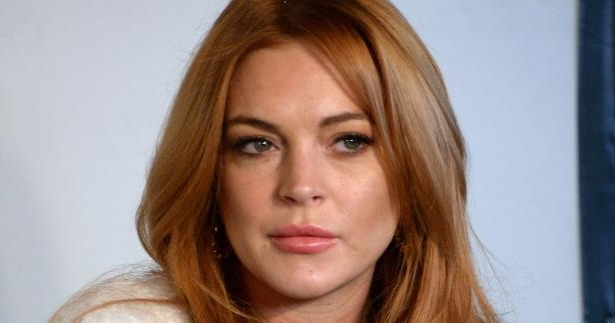 a close up of Lindsay Lohan: Lindsay Lohan Says Women Who Speak Out About #MeToo Experiences 'Look Weak'