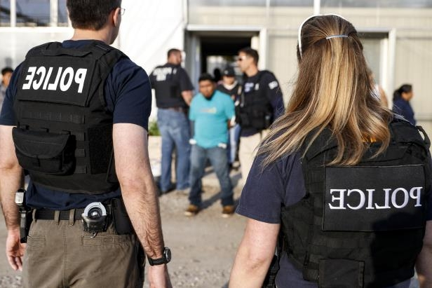Government agents detain suspects during an immigration raid in Castalia, Ohio. Regular raids are a key part of President Donald Trump's administration's crackdown on immigrants living in the U.S. illegally.