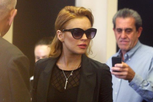 Slide 23 of 37: BEVERLY HILLS, CA - SEPTEMBER 24:  Actress Lindsay Lohan arrives to the Beverly Hills Courthouse for her probation hearing, after her probation was revoked, on September 24, 2010 in Los Angeles, California. Judge Elden Fox revoked her probation earlier in the week after she failed a drug test but is has held it until today. The judge had warned that any failure could send her back to jail. Lohan spent 13 days jail followed by 23 days in a court-ordered drug rehab program after she was sentenced for an earlier violation of her probation on July 6 for the August 2007 no-contest plea to drug and alcohol charges stemming from two separate traffic accidents.   (Photo by David McNew/Getty Images)