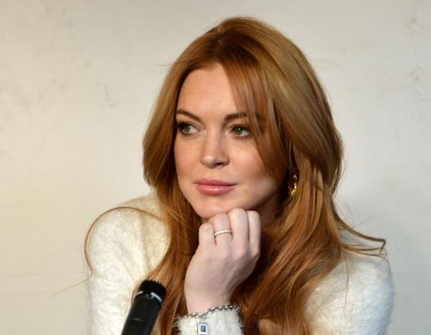 Slide 27 of 37: PARK CITY, UT - JANUARY 20: Actress Lindsay Lohan speaks at the Lindsay Lohan Press Conference at Social Film Loft during the 2014 Park City on January 20, 2014 in Park City, Utah. (Photo by George Pimentel/Getty Images)