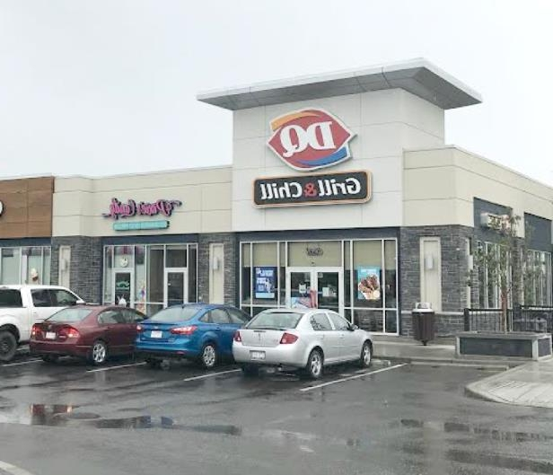 a car parked in front of a store: ATCO technicians were able to find the source of a natural gas leak that had been ongoing at a northeast Calgary Dairy Queen since it opened three years ago.