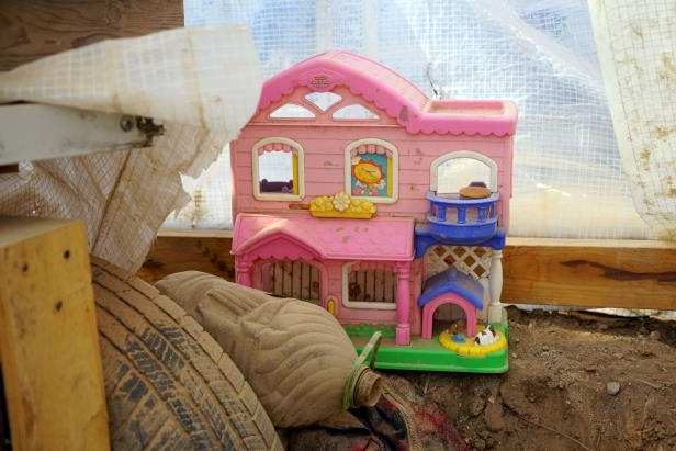 A child's toy sits inside a compound at Amalia, New Mexico, where authorities arrested five adults on suspicion of child abuse. Eleven children were rescued from the site.