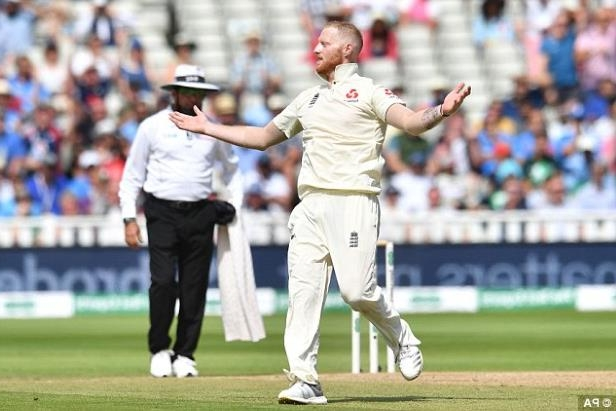 a cricket player during a game: Stokes starred in the cricket last week (pictured) as England beat India at Edgbaston