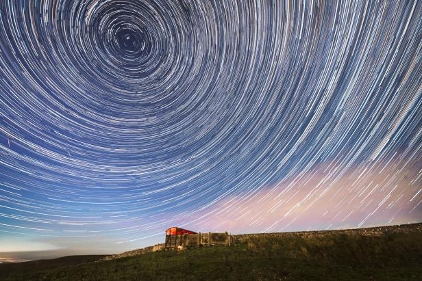 a view of the water: A composite image shows Perseid meteors cutting through the stars wheeling over Yorkshire Dales National Park in the U.K.