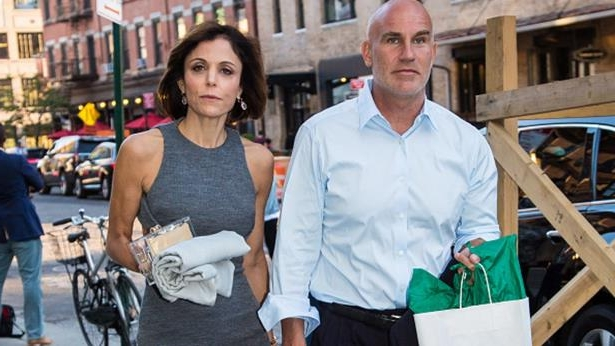 Bethenny Frankel et al. that are standing in the street: Bethenny Frankel and Dennis Shields are seen leaving SoHo House on June 14, 2016 in New York, New York.