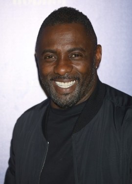 Idris Elba smiling for the camera: Idris Elba was rumored to be the next James Bond, reports stated.