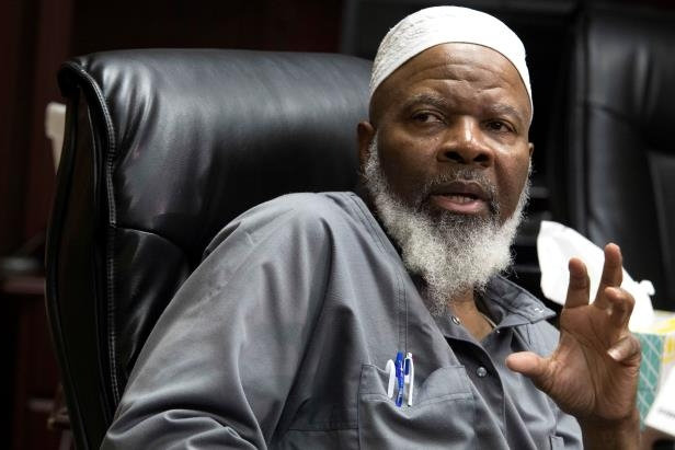 Imam Siraj Wahhaj speaks to reporters, Thursday, Aug. 9, 2018, in New York. Wahhaj, the grandfather of a missing Georgia boy,  says the remains of the child were found buried at a desert compound in New Mexico. Abdul-ghani Wahhaj was found Monday, on what would have been his fourth birthday, after he went missing in December in Jonesboro, Ga. near Atlanta.