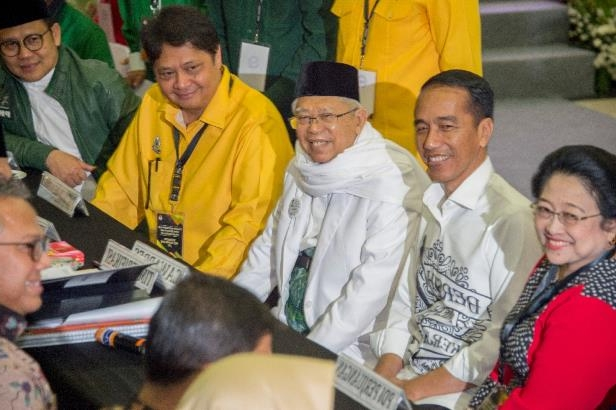Indonesian Ulema Council Ma'ruf Amin (3rd L) is expected to bolster the Islamic credentials of President Joko Widodo (2nd L)