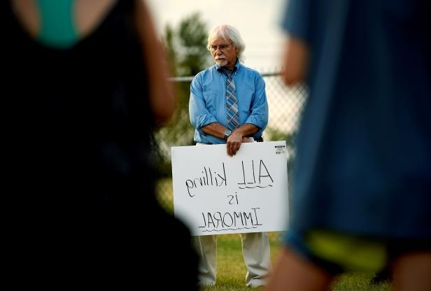 Jon Warkentin, of Nashville, gathers with protesters outside the Riverbend Maximum Security Institution before the execution of Billy Ray Irick in Nashville, Tenn., Thursday, Aug. 9, 2018. Irick was convicted in 1986 in the death of Paula Dyer, a 7-year-old Knoxville girl he was babysitting. (Andrew Nelles/The Tennessean via AP)