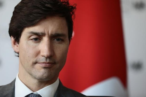 Justin Trudeau wearing a suit and tie: Prime Minister Justin Trudeau and other Canadian officials may have to deal with weakening solidarity among traditional allies from now on, as it stands largely alone in its diplomatic spat with Saudi Arabia, says Anthony Cary, a former British High Commissioner to Canada.
