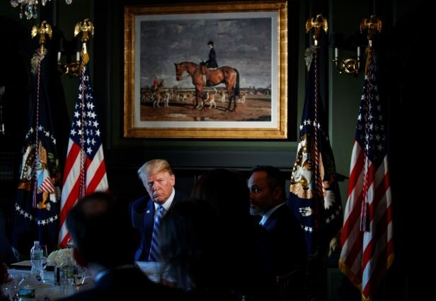 President Donald Trump listens during a meeting with state leaders about prison reform, Thursday, Aug. 9, 2018, at Trump National Golf Club in Bedminster, N.J. (AP Photo/Carolyn Kaster)