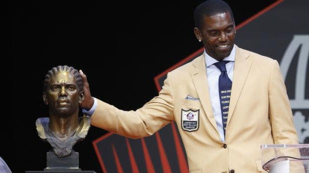 Randy Moss wearing a suit and tie