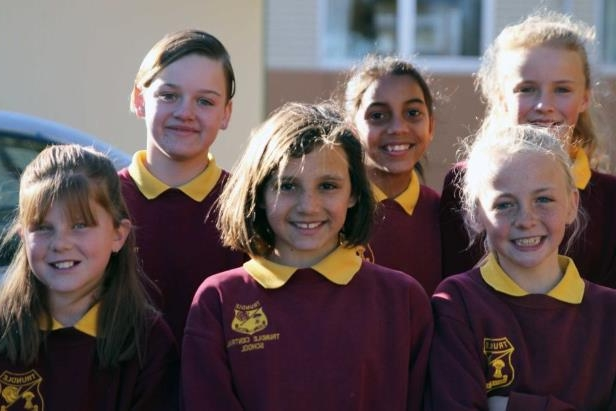 Students at Trundle Central School who are smiling through the drought.