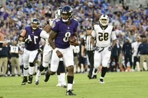 Watch: Lamar Jackson scrambles for first rushing TD of pro career