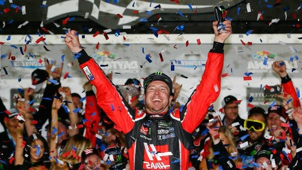 a group of people in different colors: Kurt Busch wins Daytona 500
