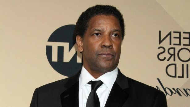 Denzel Washington wearing a suit and tie