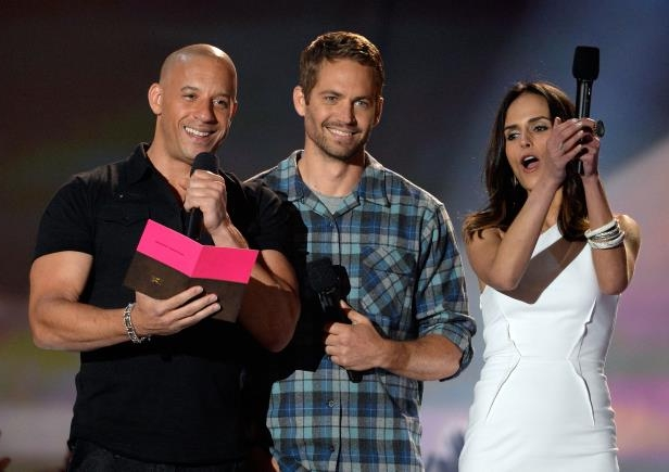 Slide 7 of 21: Co-star Jordana Brewster joined Walker and Diesel at the MTV Movie Awards where they promoted the film.