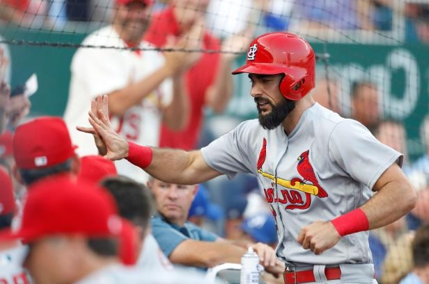 St. Louis Cardinals' Matt Carpenter is congratulated at the dugout after hitting a two-run home run in the second inning of a baseball game against the Kansas City Royals at Kauffman Stadium in Kansas City, Mo., Friday, Aug. 10, 2018. (AP Photo/Colin E. Braley)