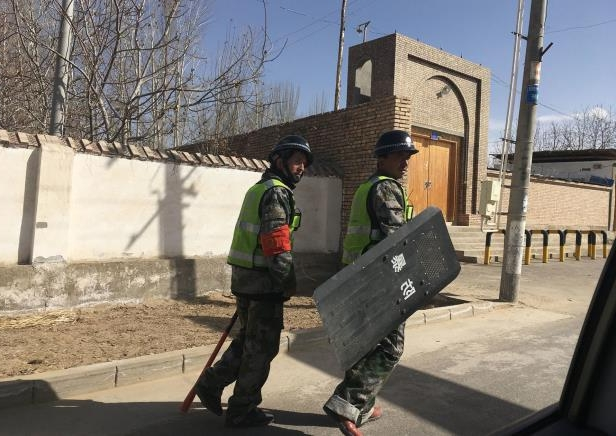 This photo taken on February 17, 2018 shows local police patroling a village in Hotan prefecture, in China's western Xinjiang region.: Local police patrol a village in Hotan prefecture, in China's western Xinjiang region, on Feb. 17, 2018. A United Nations human rights committee said the predominantly Uighur area had been turned into