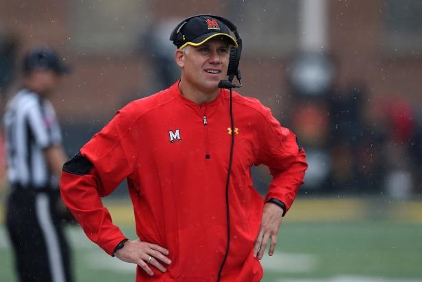 7804f34870d06 a man wearing a red hat  Maryland football coach DJ Durkin has been put on